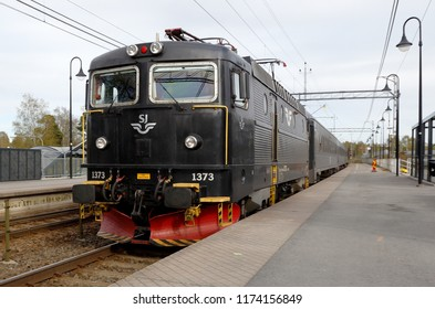 Nykvarn, Sweden - May 13, 2017: Front view of the regional passenger train operated by SJ pulled by a electric locomotive class Rc6 at the Nykvarn railroad station.