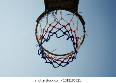 A nylon made basketball nets with blue sky background photo