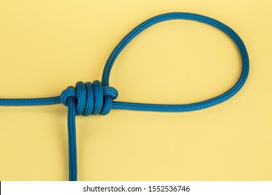 Nylon rope in hangman's knot on yellow