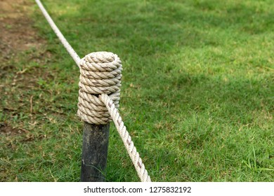 Nylon rope tied with steel pole. Nylon rope fence prohibits people entering the lawn.