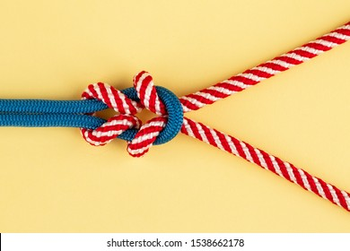 Nylon ropes in double square knot on yellow