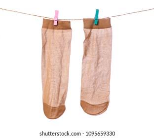 Nylon socks clothespins rope on a white background isolation