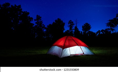 Nylon tent in North Carolina with lights inside and stars above