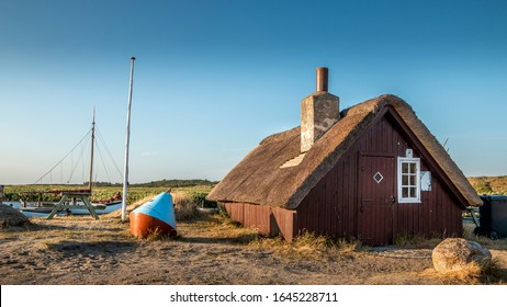 Nymindegab, Denmark - 07 Juli 2018: Small red house on the Danish west coast that is filled with beautiful nature and dunes