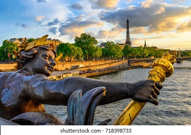 The Nymph reliefs on the bridge of Alexander III with the Eiffel Tower on background at sunset in Paris, France. Architecture and landmarks of Paris. Postcard of Paris