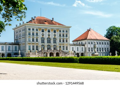 Nymphenburg Palace main building of baroque style palace with white walls and red roof view from the side. Munich, Germany