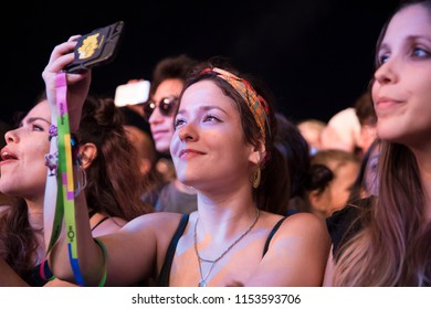 Nyon, Switzerland - 18 July 2018: enthusiastic audience cheering and dancing at concert of American rock band MGMT at Paleo Festival