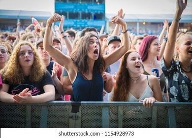 Nyon, Switzerland - 19 July 2018: feminist woman in the audience showing her muscle to say she is strong at concert of Cuban-French twins singers of band Ibeyi at Paleo Festival