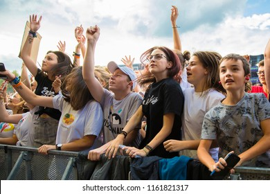 Nyon, Switzerland - 21 July 2018: crowd of young fan dancing and cheering at concert of French Rap band BigFlo & Oli at Paleo Festival