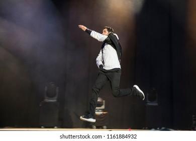 Nyon, Switzerland - 21 July 2018: Show od French stad up comedian Jamel Debbouze at Paleo Festival, Jamel arrives jumping on stage