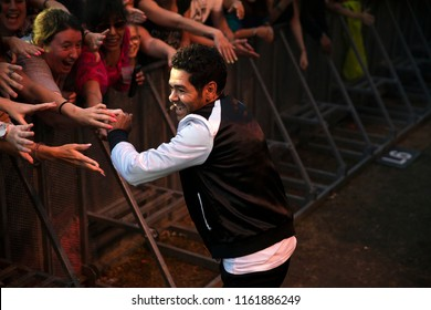 Nyon, Switzerland - 21 July 2018: Show od French stad up comedian Jamel Debbouze at Paleo Festival, Jamel is down in the pit greeting his audience