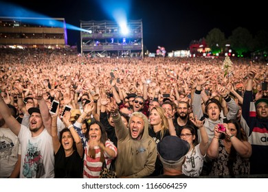 Nyon, Switzerland - 21 July 2018: crowd of audience at concert of French rap band Supreme NTM  with JoeyStarr and Kool Shen at Paleo festival