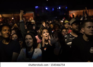 Nyon, Switzerland - 27 July 2019 :  young woman looking amazed in the audience in front of concert of French rap singer Youssoupha