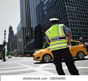 NYPD officer directing traffic in New York City.
