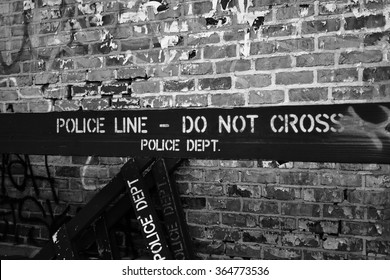 NYPD police line, do not cross against a brick wall in New York/ NYPD police line, do not cross