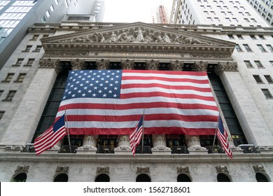 NYSE New York City/USA - September 2, 2019: The Exterior Of The New York Stock Exchange With Large American Flag Draped Along The Front Of The Building.