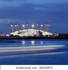 O2 Arena huge tent at the bankside of the blue Thames in London at evening
