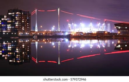 O2 arena in London/ London cityscape at night/ Royal Victoria Docks in London at night