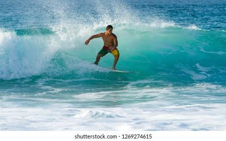 Oahu, Hawaii - 2/10/2014:  Surfing on the north shore, Oahu, Hawaii