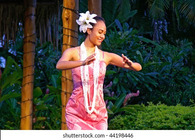 OAHU, HAWAII - DEC 24: Polynesian Cultural Center. A beautiful girl, a student from Brigham Young University-Hawaii performs hula dance on Christmas Eve on December 24, 2008 in Oahu, Hawaii