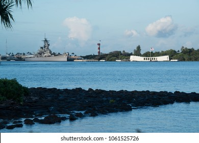 Oahu, Hawaii Feb 1, 2018: Pearl Harbor with USS Arizona Memorial depicts the beginning of war and USS Missouri Big Mo battleship floating in Oahu, Hawaii depicts the end of World War II where Japanese