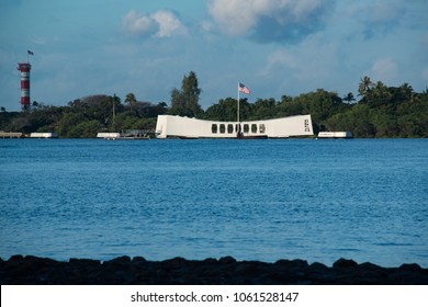 Oahu, Hawaii Feb 1, 2018: Pearl Harbor with USS Arizona Memorial depicts the beginning of war and a solemn memorial floating over the graves of naval sailors lost during the attack and sinking of the