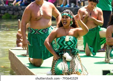 Oahu, Hawaii - May 27, 2016: Maori Performers on a canoe float at the Polynesian Cultural Center, a popular tourist attraction of Oahu.