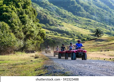 Oahu, Hawaii, October, 2010: A tour group travels on ATVs on the Kualoa Ranch to see movie filming sites in Oahu, Hawaii