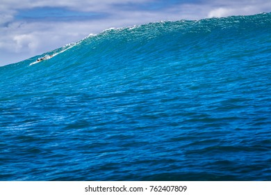 Oahu Hawaii USA, Dec. 5, 2015: A Surfer rides a giant Ocean wave during a big swell on the north shore