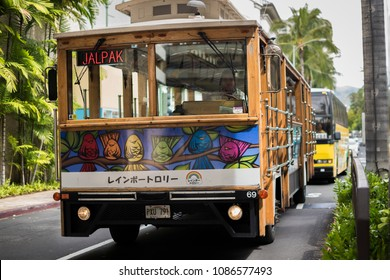 Oahu, Hawaii/United States - 23 February 2018:  Waikiki Trolley in the streets of Oahu. The front of it shows a Heather Brown's art.