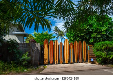 OAHU / USA - 09 JANUARY 2019: Fence of the property made of the decorative colorful surf boards, located near the famous Pipeline surf spot on the North Shore of Oahu