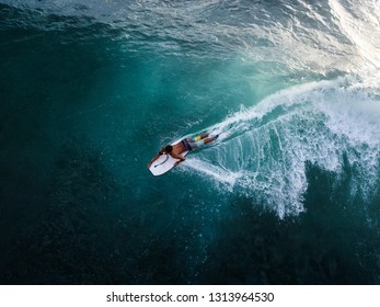 OAHU / USA - 15 NOVEMBER 2018: Surfer rides the ocean tropical wave on bodyboard. Aerial view of Makaha surf spot, west coast of Oahu, Hawaii