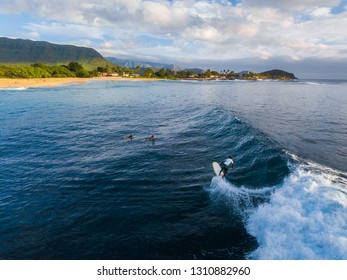 OAHU / USA - 17 NOVEMBER 2018: Panorama of the surf spot Makaha with the surfer riding the wave. Oahu, Hawaii