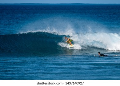 OAHU / USA - DECEMBER 05, 2019: Surfer gets barreled at the Tracks surf spot located on the West Shore of Oahu (leeward) in Hawaii