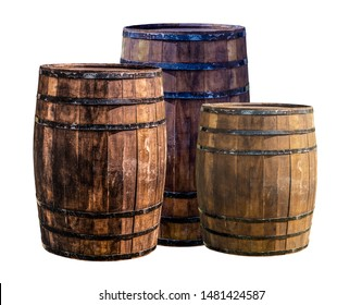 oak barrel, three dark brown wooden wine storage containers at the winery