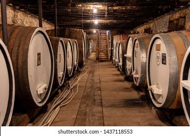 Oak Barrels In the Cellar on a Winery Tour in Victoria, Australia