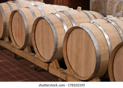 Oak barrels in which the wine matures at a winery.