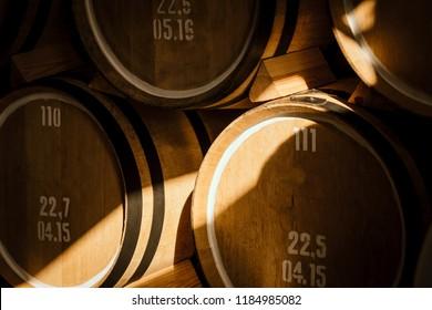 Oak barrels. Wine barrels stacked in the cellar of the winery.