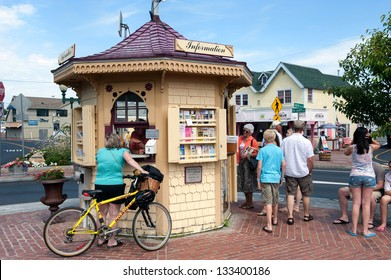 OAK BLUFFS, MA - June 22: Biker consults the tourist information on June 22, 2010 in Oak Bluffs at Martha's Vineyard. Oak Bluffs is one of the islands main points of arrival for summer tourists.