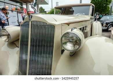 OAK BROOK, ILLINOIS/USA - JUNE 16, 2019: This closeup shows the headlights and chrome grill of a shiny 1936 Packard on display at the 51st Annual Father's Day Classic Car Show at Oakbrook Center.