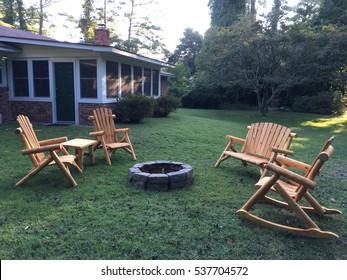 Oak Chairs Surrounding A Backyard Fire Pit