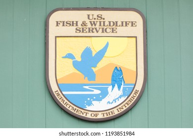 OAK HARBOR, OH / USA - MAY 19, 2018: U. S. Fish and Wildlife Service sign at Ottawa National Wildlife Refuge Visitor Center.