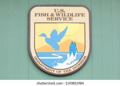 OAK HARBOR, OH / USA - MAY 19, 2018: U. S. Fish and Wildlife Service sign at Ottawa National Wildlife Refuge Visitor Center.