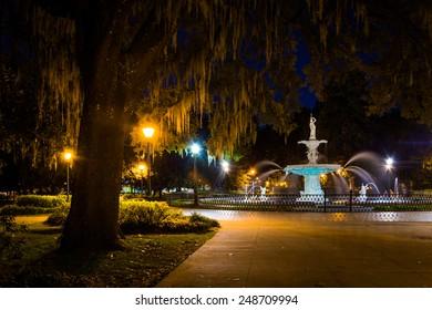 Oak tree and fountain at night in Forsyth Park, Savannah, Georgia.