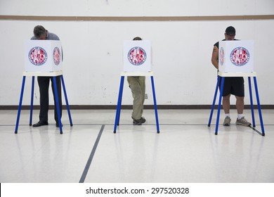 Oak View, California, USA, November 4, 2014, citizen votes in election booth polling station in gymnasium