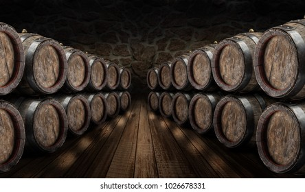 Oak wine barrels in the wine cellar. Old stone wall at the background.
