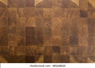 Oak wooden butcher chopping block, natural durable end grain hard wood board texture background pattern close up