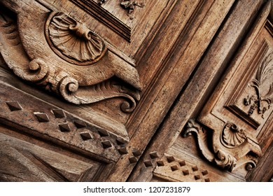 Oak wooden door on the facade of a French mansion