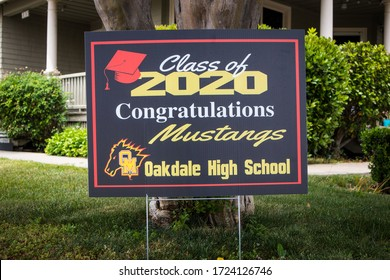 OAKDALE, CALIFORNIA / USA - APRIL 29, 2020: People in the community post signs in their front yards to congratulate graduates of the Class of 2020 during the covid pandemic.