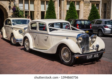 Oakham, Rutland / England 06/26/15: 1936 Jaguar SS Saloon Vintage car used as a Wedding carriage for the bride and groom. There are only 5 remaining models of this 1936 Jaguar in the world.